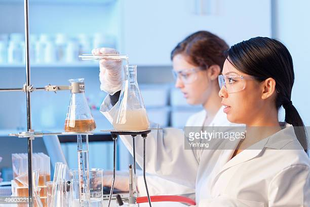 Women University Students Working Together in a Chemistry Laboratory Horizontal