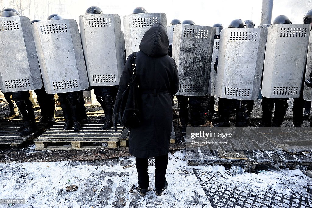 Women urge policemen not to not to use force against protesters on Grushevskogo Street on January 30, 2014 in Kiev, Ukraine. Ukraine's Prime Minister Mykola Azarov and his cabinet resigned two-days ago following months of protests, while parliament is also scrapping a number of controversial anti-protest laws. Radical anti-government protesters have started to build new walls inside the existing barricades in defiance of the Government's proposed Amnesty.