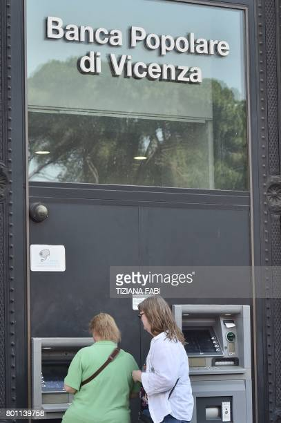 Women use an ATM of Italian bank 'Banca Popolare di Vicenza' at Piazza Venezia in central Rome on June 26 2017 Up to 3900 voluntary redundancies and...