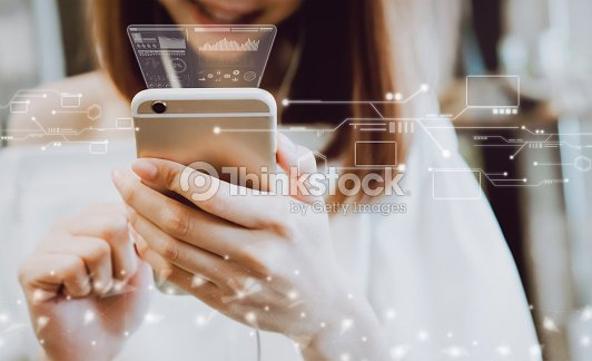 Women using a smartphone in the display and technology advances in stores. Take your screen to put on advertising. : Stock Photo