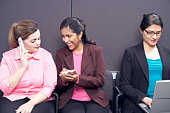 Women using technological devices
