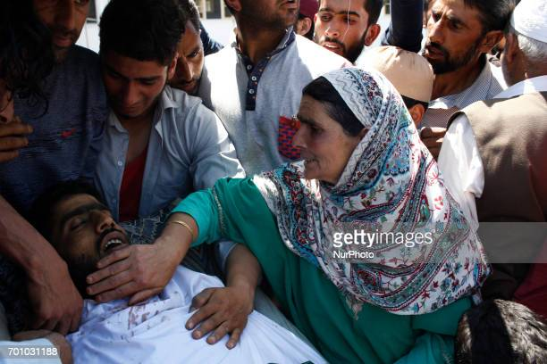 A women wails near the body of Tauseef AhmedA civilian in Tengpun south of Srinagar Indian Administrated Kashmir June 22 2017 Tauseef died during a...