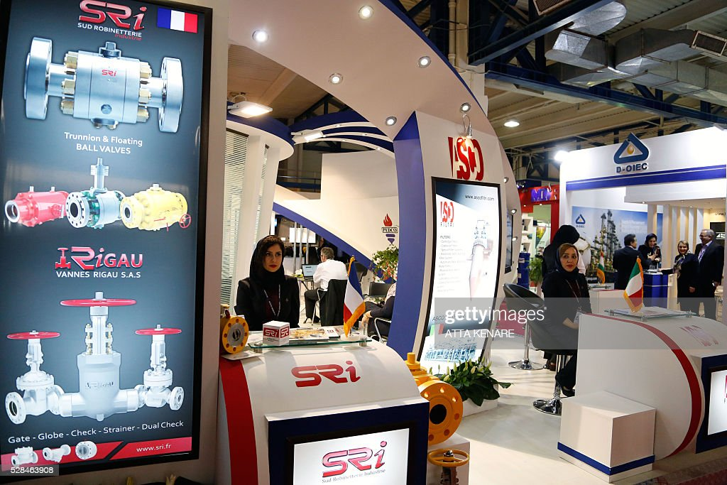 Women wait at the stand of the French Sud Robinetterie Industrie (SRI) company on May 5, 2016 during the 21st International Oil, Gas, Refining and Petrochemical Exhibition in the Iranian capital Tehran. / AFP / ATTA