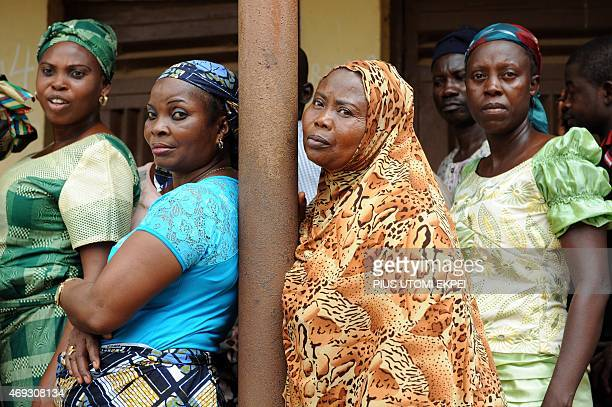 Women wait before casting their vote at the Epe district of Lagos on April 11 2015 Nigerians were on Saturday voting to choose new state governors...