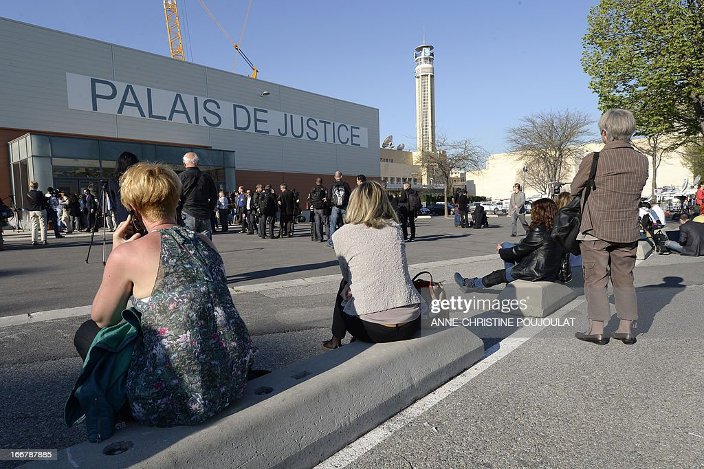 Women wait for the start of the trial of five managers from French company PIP who face fraud charges for allegedly selling faulty breast implants that sparked global health fears, on April 17, 2013 in front of the Marseille's courthouse. Health safety authorities report on April 12, 2013, that nearly 15,000 French women have had the PIP implants removed.
