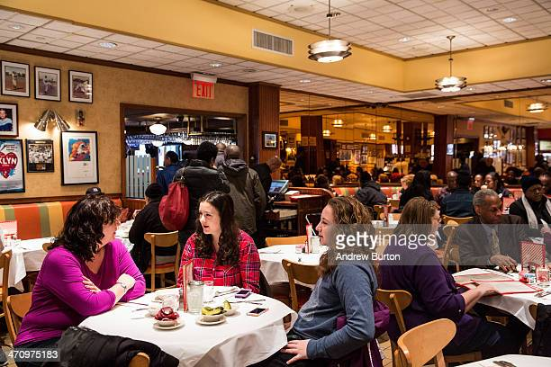 Women wait for their food at Junior's restaurant a staple of Brooklyn dining since the 1950s on February 21 2014 in the Downtown Brooklyn...