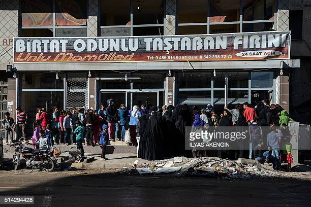 Women wait in front of a backery on March 8 2016 during International Women's day in Cizre district Residents of Cizre in southeastern Turkey began...