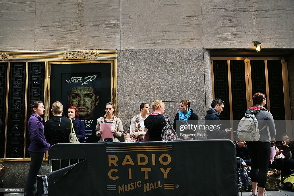 Women wait outside of Radio City Music Hall before an audition for a spot with the Rockettes on April 30, 2013 in New York City. In order to be considered for the Rockettes, dancers must be at least 18 years old, measure at a height between 5 feet 6 inches and 5 feet 10 1/2 inches without their heels on. The dancers must also be be proficient in numerous dance styles, including jazz, tap and ballet. The women who make it through the extremely competitive competition to land a spot with the legendary dance group will perform in the Radio City Christmas Spectacular which runs from November 8 -December 30 2013.