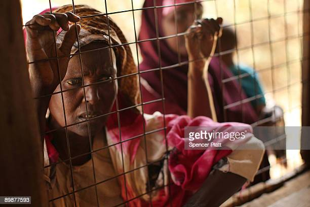 Women wait to receive medicine inside of a Doctors Without Borders medical station in Dadaab the world�s biggest refugee camp August 19 2009 in...