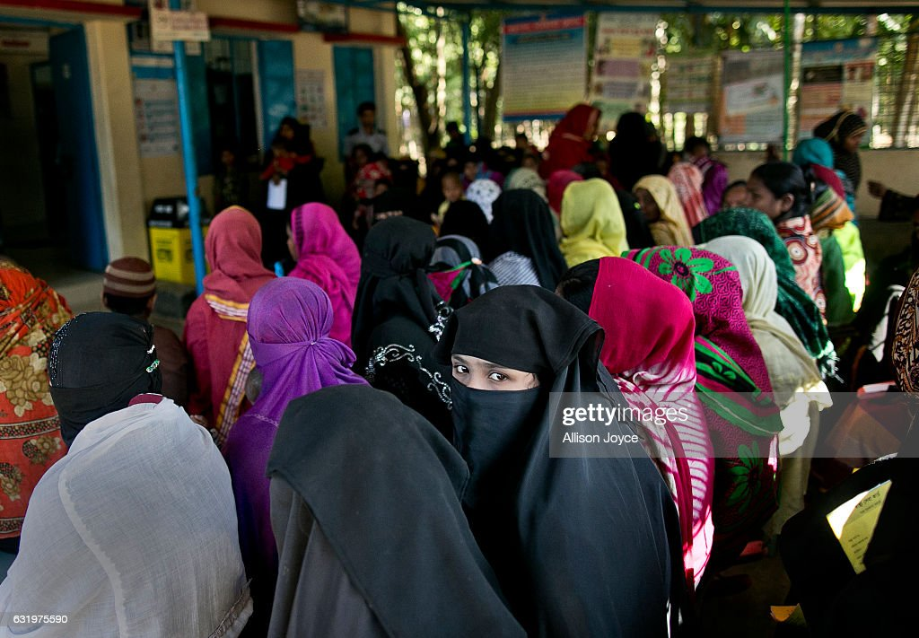 Women wait to see doctors at the IOM Kutapalong clinic January 18, 2017 in Coxs Bazar, Bangladesh. More than 65,000 Rohingya Muslims have fled to Bangladesh from Myanmar since October last year, after the Burmese army launched a campaign it calls 'clearance operations' in response to an attack on border police on October 9, believed to have been carried out by Rohingya militants. Waves of Rohingya civilians have since fled across the border, most living in makeshift camps and refugee centers with harrowing stories on the Burmese army committing human-rights abuses, such as gang rape, arson and extrajudicial killing. The Rohingya, a mostly stateless Muslim group numbering about 1.1 million, are the majority in Rakhine state and smaller communities in Bangladesh, Thailand and Malaysia. The stateless Muslim group are routinely described by human rights organizations as the 'most oppressed people in the world' and a 'minority that continues to face statelessness and persecution.'
