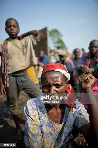 A women waits for a food distribution in UNHCR camp for displaced persons on January 14 2013 in Goma Democratic Republic of Congo The war in Congo...