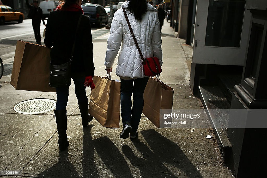 Women walk down Broadway with shopping bags on February 7, 2013 in New York City. In another indicator of a slowly strengthening economy, chain stores including Macy's Inc., Target Corp and Gap Inc. reported today January sales that exceeded analysts' estimates.