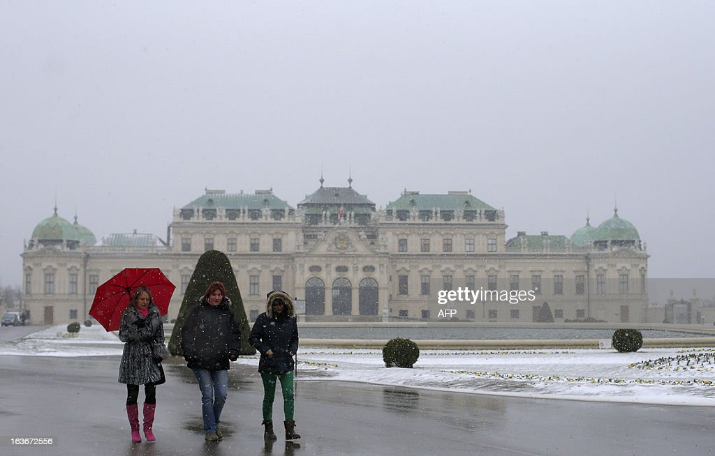 Women walk in the gardens of the Belvedere Palace in Vienna on March 14, 2013. Temperatures in the Austrian capital were around the freezing point.