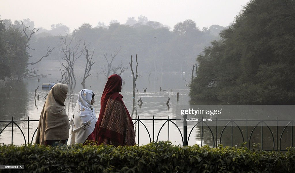 Women walk in the Hauz Khas Complex on a chilly evening on January 3, 2013 in New Delhi, India. A cold wave is sweeping across north India sending temperatures plunging. Delhi Wednesday witnessed the coldest day in the past 44 years.