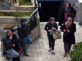 Women walk past a metro station in Algiers on March 16 2015 Harassment in public places in Algeria is now punished by two to six months of prison...