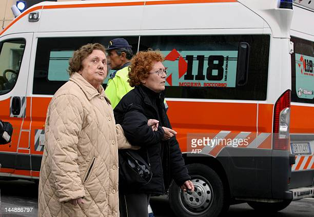 Women walk past an ambulance after another earthquake shook downtown Finale Emilia in the Modena province on May 20 2012 A powerful earthquake shook...
