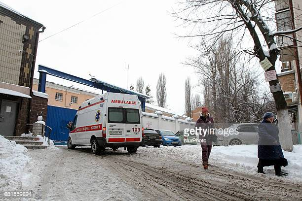 A women walk past an Ambulance vehicle entering a Lukyanivske PTDC where a prisoner cut his ear to protest overnight into January 12 2017 in Kyiv...