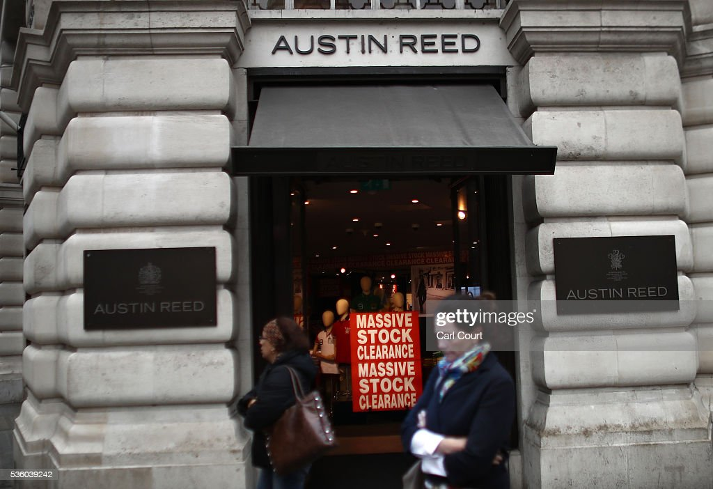 Women walk past an Austin Reed store on May 31, 2016 in London, England. After going into administration last month and failing to find a buyer, the company today announced that all 120 Austin Reed stores will close by the end of June with a loss 1,000 jobs.