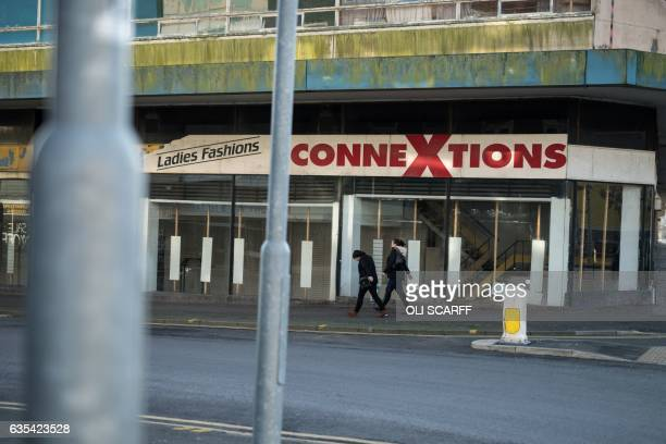 Women walk past the derelict Hanley Shopping Centre in the centre of StokeonTrent central England on February 13 2017 The byelection for the seat of...
