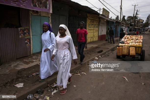 Women walk to church in the Kibera slum on August 13 2017 in Nairobi Kenya A day prior demonstrations turned violent in some areas throughout Kenya...