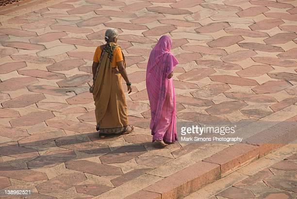 Women walking around Taj