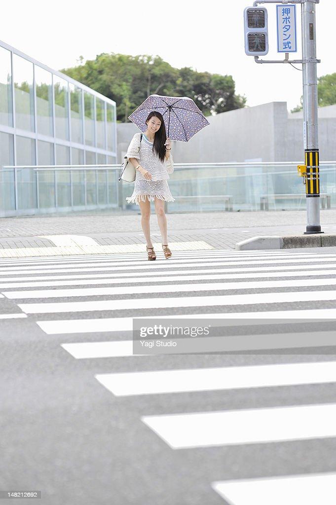 Women walking in the crosswalk,smiling : Stock Photo