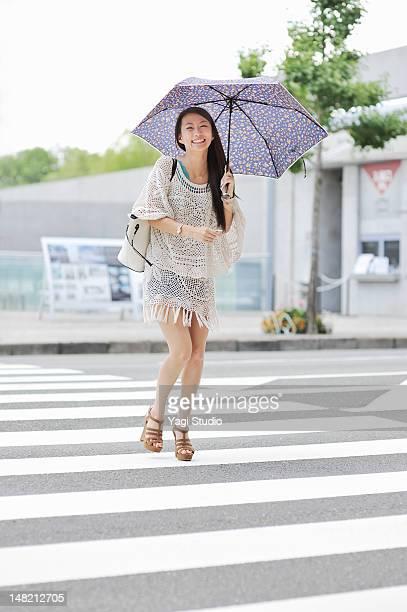 Women walking in the crosswalk,smiling