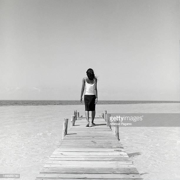 women walking on a dock in Cat Island Bahamas