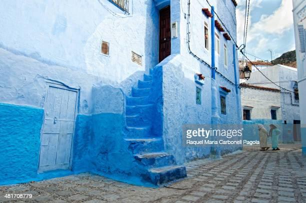 Women walking on the blue streets