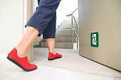 women walking to the emergency fire exit door