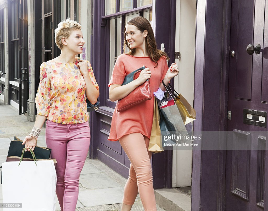 Women walking with shoppingbags on street. : Stock Photo