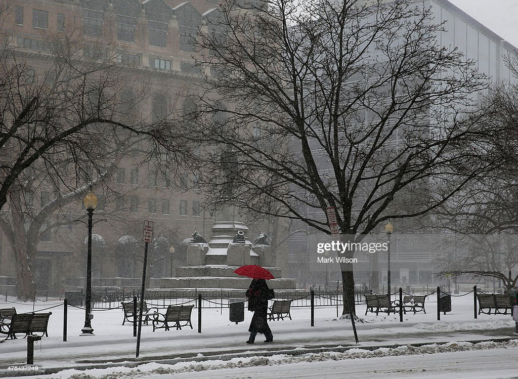 A women walks in the snow, on March 3, 2014 in Washington, DC. The federal governent is closed due to major snowstorm that is expected to dump up to a foot of snow in the Washington area.