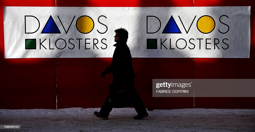 A women walks past logo of Davos/Klosters area ahead of the World Economic Forum annual meeting on January 24 2011 in Davos The eurozone's debt...