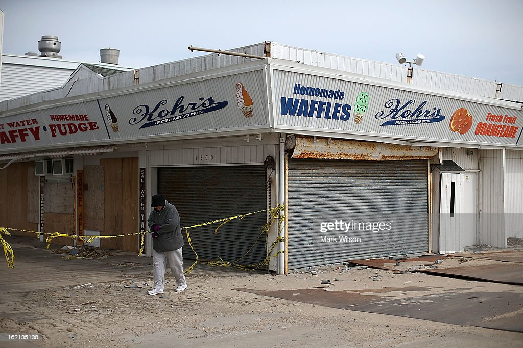 A women walks past the closed boardwalk that was damaged by Superstorm Sandy, February 19, 2013 in Seaside Heights, New Jersey. Governor Chris Christie has estimated that damage in New Jersey caused by Superstorm Sandy could reach $37 billion.