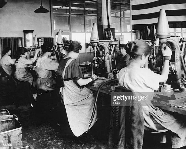 Women war workers drilling engine parts in a Detroit aircraft factory 1917