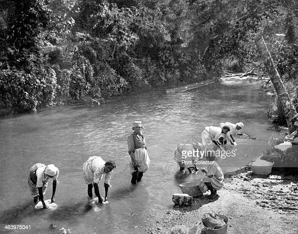 Women washing clothes in the river Port Antonio Jamaica c1905 Photograph from Picturesque Jamaica by Adolphe Duperly Son