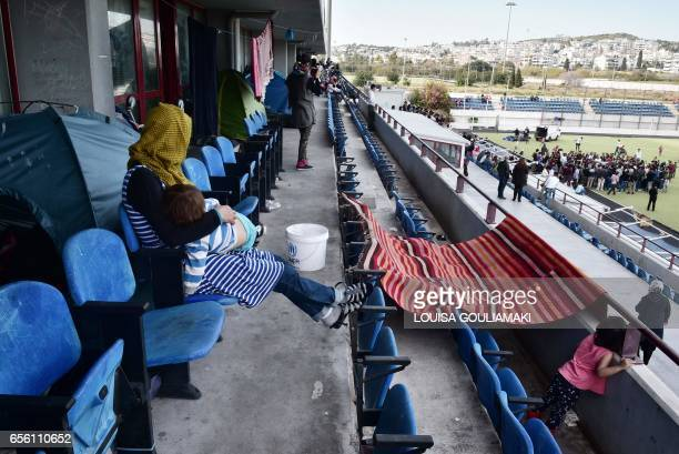 Women watch from a tribune the celebrations of Nowruz the Persian New Year on March 21 2017 at the Hockey refugee camp situated at the former Olympic...