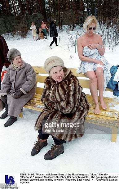 Women watch members of the Russian group 'Mors' literally 'Seahorse' swim in Moscow's Sierebnij Bor park this winter The group says that it is the...