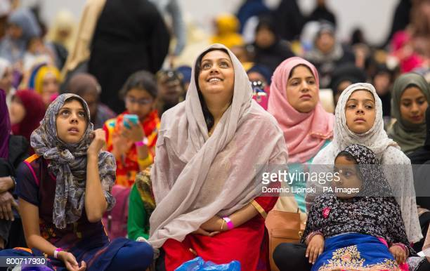 Women watch speeches on a big screen during the Eid in Excel event in association with the AlKhair Foundation at ExCeL London which is London's...
