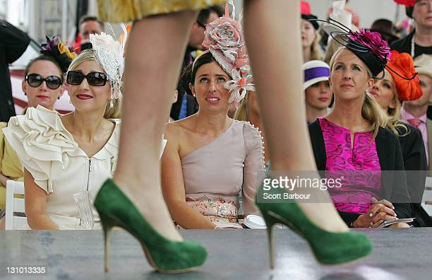 Women watch the Myer Fashions on the Field on Melbourne Cup Day at Flemington Racecourse on November 1 2011 in Melbourne Australia