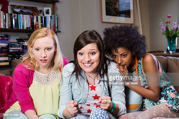 Women watching a game on television.
