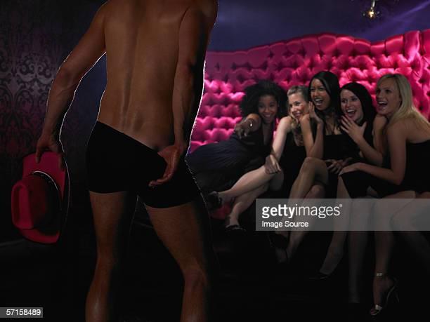 Women watching strip tease