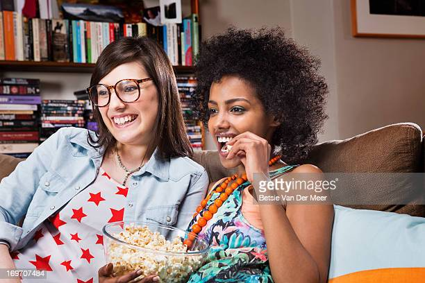 Women watching television in livingroom.