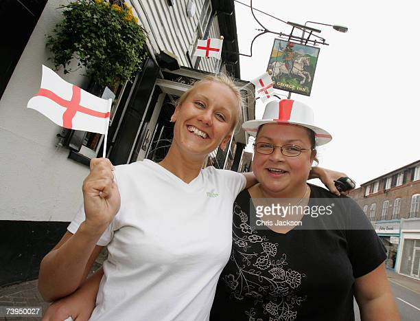 Women wave flags during the Capital Radio St Georges Day Recording at Ye Old St Georges Pub in Beckenham on April 23 2007 in London England