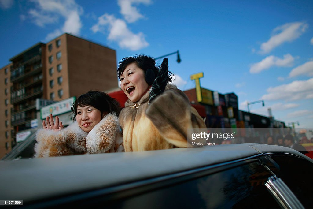 Women wave while riding in the Flushing Chinese New Year Parade January 31 2009 in the Queens borough of New York City Chinese New Year marks the...
