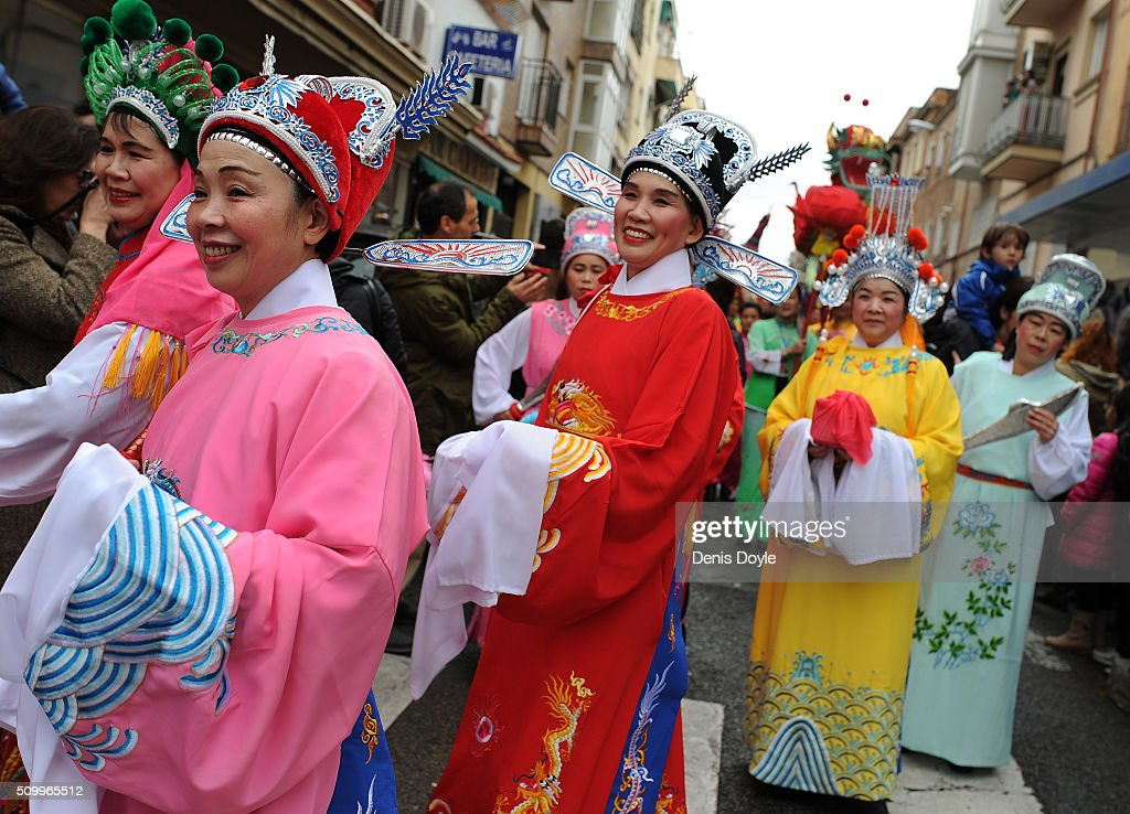 Women wear colourful costumes during the procession to celebrate The Year of The Monkey on February 13, 2016 in Madrid, Spain. The Madrid Town Hall has organised this year's lunar year celebrations for the first time in Madrid's Chinatown district of Usera.