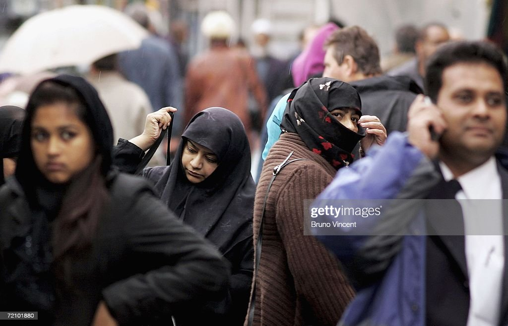 Women wearing a Niqab shop in Whitechapel market on October 6 2006 in London Leader of the House of Commons Jack Straw has said that he asked Muslim...