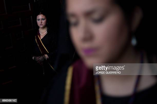 Women wearing a traditional 'Mantilla' stand during the 'Gitanos' brotherhood procession on April 9 2017 in Ronda during the Holy Week Christian...