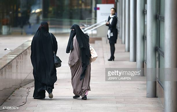 Women wearing burqas walk past the Palace of Justice in The Hague on December 1 2014 The Dutch cabinet approved on May 22 2015 a partial ban on...