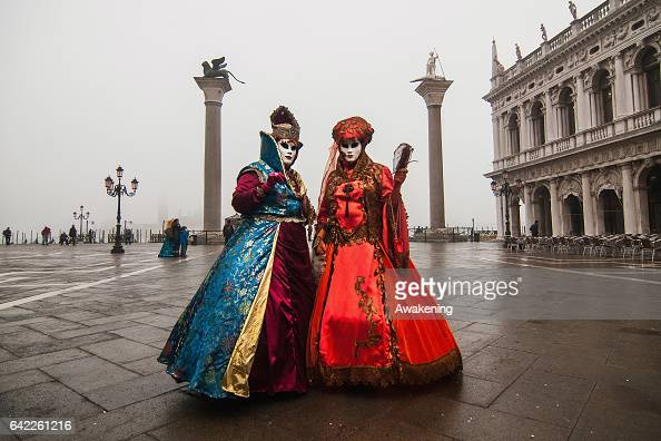 Women wearing carnival costume pose in St Mark square during the 2017 Venice Carnival on February 17 2017 in Venice Italy The 2017 Carnival of Venice...